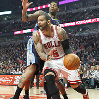 26 March 2012: Chicago Bulls power forward Carlos Boozer (5) drives past Denver Nuggets small forward Wilson Chandler (21) during the Denver Nuggets 108-91 victory over the Chicago Bulls at the United Center, Chicago, Illinois, USA. NOTE TO USER: User expressly acknowledges and agrees that, by downloading and or using this photograph, User is consenting to the terms and conditions of the Getty Images License Agreement. Mandatory Credit: 2012 NBAE (Photo by Chris Elise/NBAE via Getty Images)