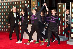 © Licensed to London News Pictures. 18/02/2018. Demonstrators protest on the red carpet for the EE British Academy Film Awards 2018, held at the Royal Albert Hall, London, UK. Photo credit: Ray Tang/LNP
