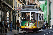 Lisbon's nº28 yellow tram at Rua do Loreto, on his way through the central, most historic region of the city.