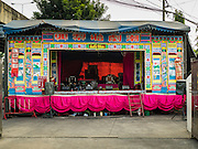 08 DECEMBER 2016 - BANGKOK, THAILAND: The stage for a Chinese opera (also called ngiew in Thailand) at Pek Leng Keng Shrine in the Khlong Toei neighborhood of Bangkok. Public performances of music and celebration were banned during the first 30 days of the mourning period for Bhumibol Adulyadej, the Late King of Thailand. Now, nearly two months after the revered monarch's death, Bangkok street life is returning to normal and Chinese temples and shrines are once again scheduling operas.      PHOTO BY JACK KURTZ