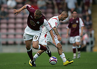 Photo: Lee Earle. <br /> Northampton Town v Swindon Town. Coca Cola Championship. 11/08/2007. <br /> Swindon's Christian Roberts (R) battles with Andy Holt.