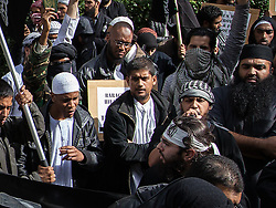 """© Licensed to London News Pictures . London , UK . SIDDHARTHA DHAR (c wearing dark jacket and light shirt) at a Muslims Against Crusades demonstration outside the American Embassy in Grosvenor Square in London , on the ninth anniversary of the 9/11 attacks , 11th September 2010 . Dhar is believed to be one of five executioners featured on a recent ISIS video filmed in Syria , alongside Mohammed Reza Haque (known as """" Giant """" ) . Photo credit : Joel Goodman/LNP"""