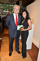The Brazilian Ambassador to the UK ROBERTO JAGUARIBE and NANCY DELL'OLIO at the Art of Futebol - a charity auction of 11 footballs signed by 11 Brazilian legends from Pele to Neymar & decorated and designed by 11 leading contemporary artists in aid of Action for Brazil's Children Trust held at the Brazilian Embassy, 16 Cockspur Street, London on 10th July 2014.