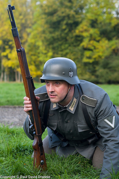 A Re-enactor portrayiing a German infantryman with a Mauser K98 rifle during a battle battle re-enactment in on Pickering Showground<br /> <br /> 17/18 October 2015<br />  Image © Paul David Drabble <br />  www.pauldaviddrabble.co.uk