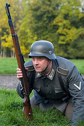 A Re-enactor portrayiing a German infantryman with a Mauser K98 rifle during a battle battle re-enactment in on Pickering Showground<br />