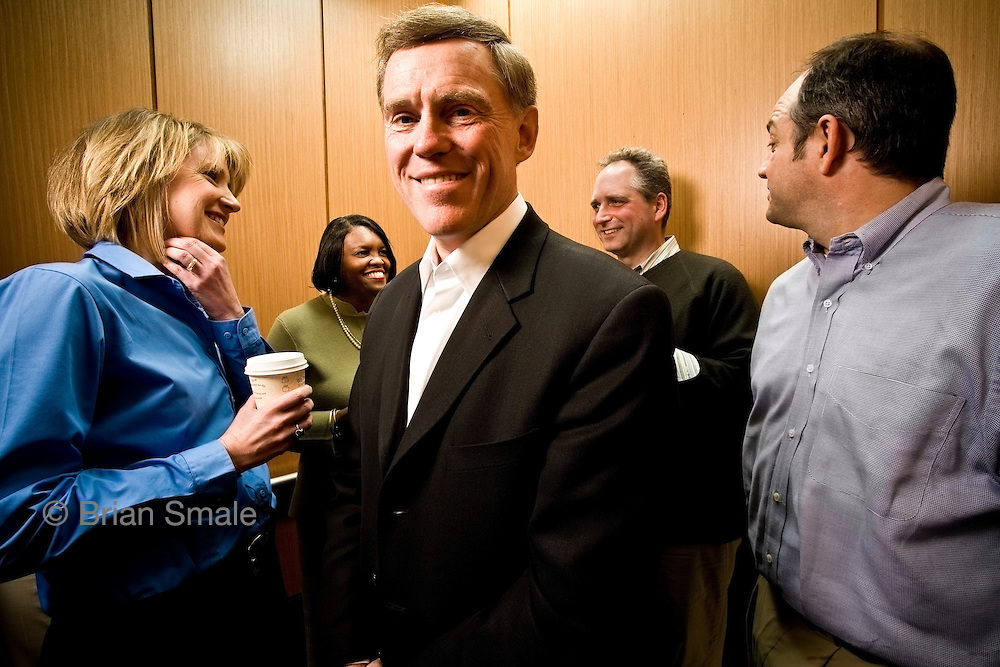 Kerry Killinger, former CEO of Washington Mutual Bank (WAMU).  Photographed with employees in the elevator at WAMU's Seattle headquarters,  by Brian Smale for Fortune Magazine.