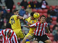Photo: Andrew Unwin.<br />Sunderland v Southampton. Coca Cola Championship. 11/11/2006.<br />Southampton's Gareth Bale (C) battles with Sunderland's Dean Whitehead (R).