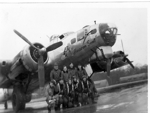 "Lewis Herron's crew, with their aircraft ""Heaven Sent."""