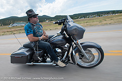 Krazy J Kieffer on the Annual Cycle Source and Michael Lichter Rides (combined this year) left from the new Broken Spoke area of the Iron Horse Saloon during the Sturgis Black Hills Motorcycle Rally. SD, USA.  Wednesday, August 10, 2016.  Photography ©2016 Michael Lichter.