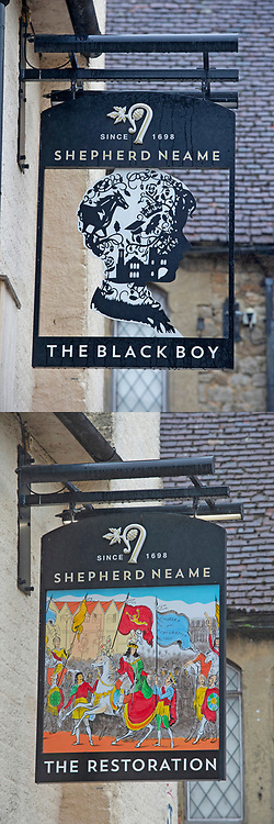 ©Licensed to London News Pictures 19/08/2020             Sevenoaks, UK. Comparison picture today (19/08/2020) The Restoration pub sign and from the (30/06/2020) The Black Boy pub sign. The Black Boy pub in Sevenoaks, Kent which is over 400 years old has changed its name over racism fears to The Restoration. Photo credit: Grant Falvey/LNP
