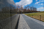 Washington, DC, USA -- February 14, 2020. A  wide angle photo of visitors walking along the path at the Vietnam Veterans Memorial.