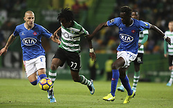 December 1, 2017 - Lisbon, Portugal - Sporting's forward Gelson Martins (C) vies with Belenenses's midfielder Bouba Sare (R) and Belenenses's midfielder Andre Sousa during the Portuguese League  football match between Sporting CP and CF Belenenses at Jose Alvalade  Stadium in Lisbon on December 1, 2017. (Credit Image: © Carlos Costa/NurPhoto via ZUMA Press)