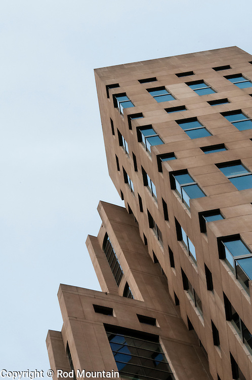 The sharp edged architecture of the Vancouver Public Library Main Branch and high-rise.
