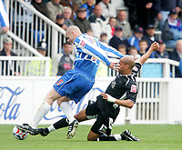 Photo: Andrew Unwin.<br />Hartlepool Utd v Swansea. Coca Cola League 1.<br />17/09/2005.<br />Swansea's Lee Thorpe (R) slides in on Hartlepool's Michael Nelson (L).