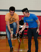 Ryan Vezina and Justin Spencer of Recycled Percussion show students and faculty how they make music with their body during their surprise visit to Laconia Middle School on Monday afternoon.  (Karen Bobotas/for the Laconia Daily Sun)