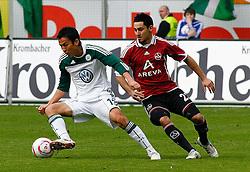 12.03.2010, Volkswagen Arena, Wolfsburg, GER, 1.FBL, VfL Wolfsburg vs 1.FC Nuernberg, im Bild Makoto Hasebe (Wolfsburg #13) und Ilkay Guendogan (Nuernberg #22) .EXPA Pictures © 2011, PhotoCredit: EXPA/ nph/  Schrader       ****** out of GER / SWE / CRO  / BEL ******