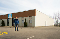 John Sandborn stands outside of Faith Alive Christian Fellowship building where he will hold services to the congregation parked in their cars on Sunday.  (Karen Bobotas/for the Laconia Daily Sun)