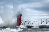 South Haven's lighthouse going through Nature's rinse cycle on Lake Michigan