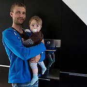 Aarhus, Denmark, June 17th, 2010. Thomas  and Theo. Thomas took two months of paternity leave to care for children while his wife Vinne works.