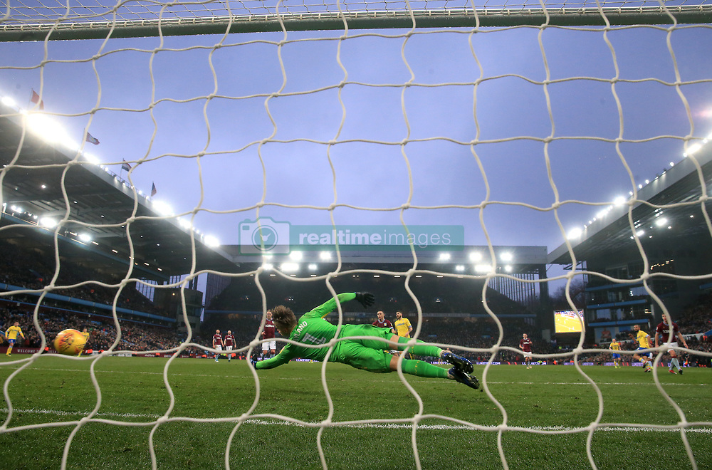 Leeds United's Kemar Roofe (right) scores his side's third goal of the game during the Sky Bet Championship match at Villa Park, Birmingham.