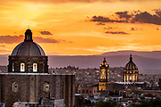 Sunset over the iconic churches in the historic center of San Miguel de Allende, Guanajuato, Mexico. San Francisco church, left, and the Immaculate Conception Church also called The Nuns.