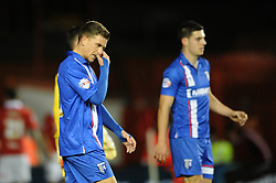 Gillingham players cut dejected players - Photo mandatory by-line: Dougie Allward/JMP - Mobile: 07966 386802 - 29/01/2015 - SPORT - Football - Bristol - Ashton Gate - Bristol City v Gillingham - Johnstone Paint Trophy