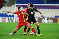 Ireland's Shane Long is tackled by Sam Ricketts of Wales (l). Friendly football international match, Wales v Republic of Ireland at the Cardiff city Stadium in Cardiff,  South Wales on Wed 14th August 2013. pic by Andrew Orchard,  Andrew Orchard sports photography,