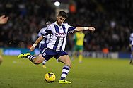 Shane Long of WBA in action. Barclays Premier league, West Bromwich Albion v Norwich city at the Hawthorns in West Bromwich, England on Sat 7th Dec 2013. pic by Andrew Orchard, Andrew Orchard sports photography.