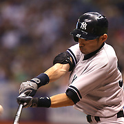 Yankees right fielder Ichiro Suzuki hits the baseball during a major league baseball game between the New York Yankees and the Tampa Bay Rays at Tropicana Field on Thursday, Sept. 17, 2014 in St. Petersburg, Florida. The Yankees won the game 3-2 and this was Jeter's last game against Tampa Bay. (AP Photo/Alex Menendez)
