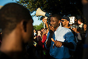 Dominique R. Alexander, president and founder of Next Generation Action Network, speaks to protesters at the Craig Ranch North community pool in McKinney, Texas on June 8, 2015.  (Cooper Neill for The New York Times)