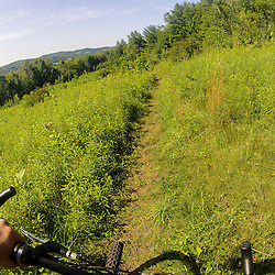 Mountain biking on Mount Ascutney in the West Windsor Town Forest. West Windsor, Vermont.
