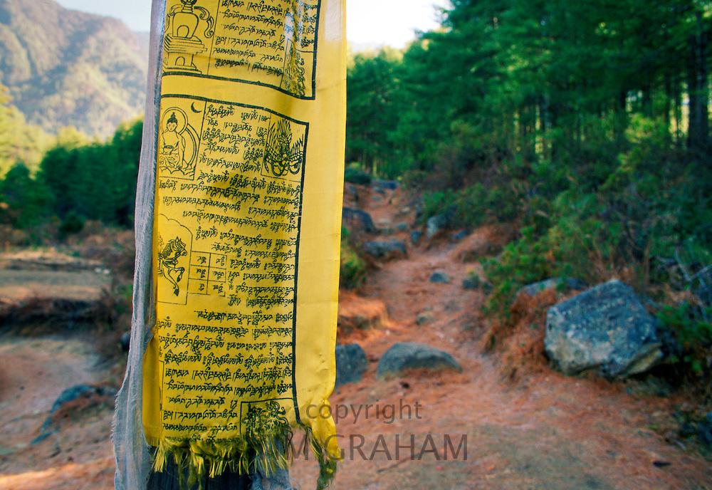 Buddhist prayer flag on mountain path to Tak Tsang Monaster, Bhutan