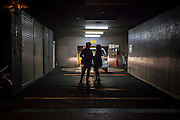 JAPAN, TOKYO, FEBRUARY 2013 -  Couple in a parking in Iidabashi [FR] Couple dans un parking a Iidabashi