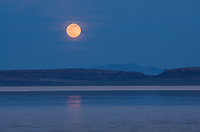 Full moon setting over Alvord Lake, a seasonal shallow alkali lake in Harney County, Oregon