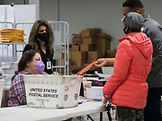 Provisional ballots are received by election workers for processing.