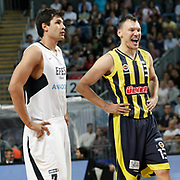 Efes Pilsen's Cenk AKYOL (L) and Fenerbahce's Sarunas JASIKEVICIUS (R) during their Turkish Basketball Legague Play-Off semi final second match Efes Pilsen between Fenerbahce at the Sinan Erdem Arena in Istanbul Turkey on Friday 27 May 2011. Photo by TURKPIX