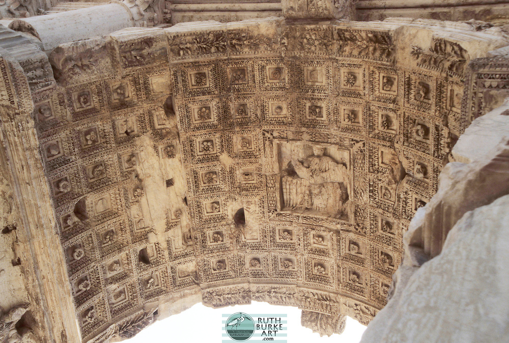 """The soffit of the axial archway is deeply coffered with a relief of the apotheosis of Titus at the center. The sculptural program also includes two panel reliefs lining the passageway within the arch. Both commemorate the joint triumph celebrated by Titus and his father Vespasian in the summer of 71.The Arch of Titus is a 1st-century honorific arch[1] located on the Via Sacra, Rome, just to the south-east of the Roman Forum. It was constructed in c. 82 AD by the Roman Emperor Domitian shortly after the death of his older brother Titus to commemorate Titus' victories, including the Siege of Jerusalem in 70 AD. Rome (/ˈroʊm/; Italian: Roma pronounced [ˈroːma] ( listen); Latin: Rōma) is a city and special comune (named """"Roma Capitale"""") in Italy. Rome is the capital of Italy and also of the homonymous province and of the region of Lazio. With 2.8 million residents in 1,285.3 km2 (496.3 sq mi), it is also the country's largest and most populated comune and fifth-most populous city in the European Union by population within city limits. Between 3.2 and 3.8 million people live in the urban area. and 4,194,068 in Rome metropolitan area.[3][4][5][6][7][8][9] The city is located in the central-western portion of the Italian Peninsula, on the Tiber within the Lazio region of Italy. Rome is referred to as """"The Eternal City"""", a notion expressed by ancient Roman poets and writers."""