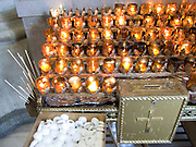illuminated little votive candles with money collection box.