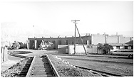 """D&RGW #489 alongside the Durango roundhouse while #268 is part way out of its stall.  Taken from coaling tower lead looking north.<br /> D&RGW  Durango, CO  <br /> In book """"Durango: Always a Railroad Town (1st ed.)"""" page 39"""