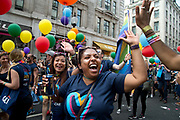 Pride in London, formally known as Pride London, is an annual LGBT pride festival and parade held each summer in London, United Kingdom. A group of Citibank employees take part in the parade, one of them high fives a spectator.