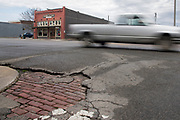 DURANT, OKLAHOMA - MARCH 24:  The old stone streets are showing through where the new road is beginning to fall apart in Durant, Oklahoma on March 24, 2017. (Photo by Cooper Neill for The Washington Post)