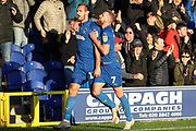 AFC Wimbledon striker James Hanson (18) and AFC Wimbledon midfielder Scott Wagstaff (7) celebrating after scoring goal to make it 1-0 during the EFL Sky Bet League 1 match between AFC Wimbledon and Shrewsbury Town at the Cherry Red Records Stadium, Kingston, England on 3 November 2018.