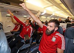 ZENICA, BOSNIA & HERZEGOVINA - Sunday, October 11, 2015: Wales' Gareth Bale and Joe Ledley on the team's return flight to Cardiff after qualifying for the UEFA Euro 2016 finals despite a 2-0 defeat to Bosnia and Herzegovina during the UEFA Euro 2016 qualifying match. (Pic by David Rawcliffe/Propaganda)