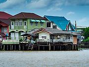 20 HULY 2017 - BANGKOK, THAILAND: Houses on stilts on the Chao Phraya River as it flows through Bangkok.       PHOTO BY JACK KURTZ