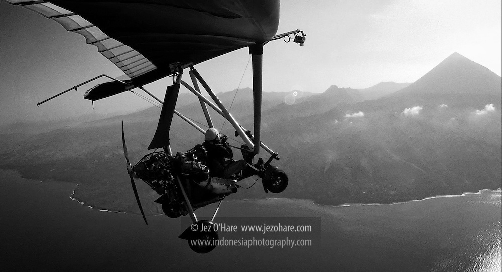 Jez O'Hare flying his trike microlight from Labuan Bajo to Ende, passing Mt. Inerie near Bajawa, Flores, NTT,  Indonesia.