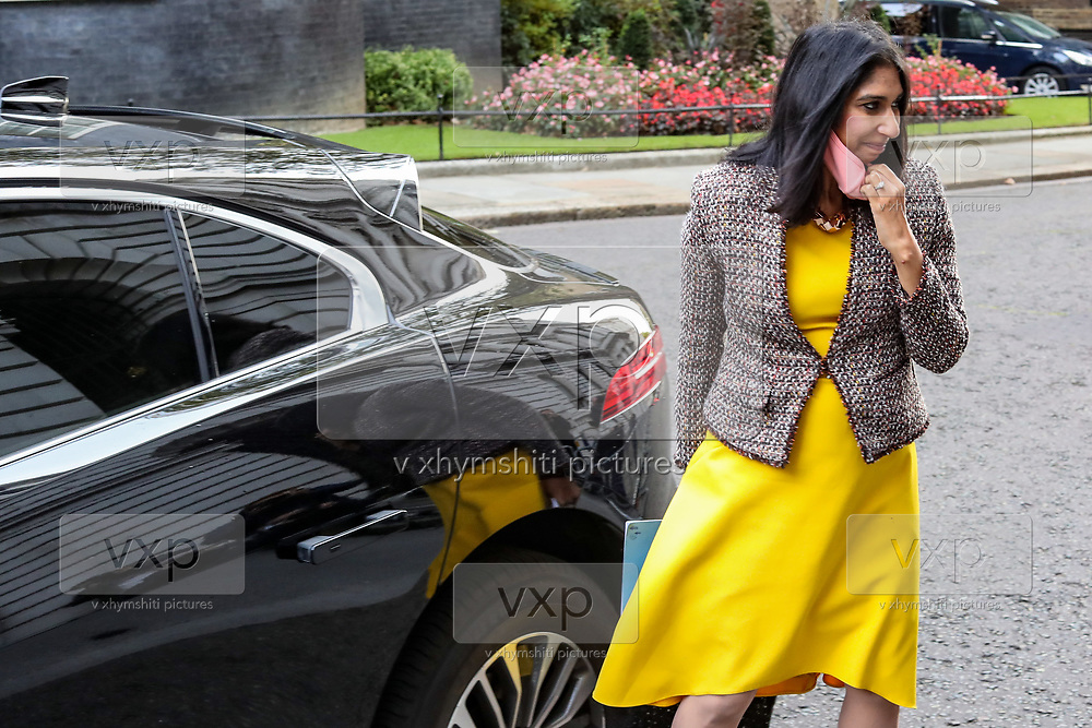 Attorney General Suella Braverman removes her facemask as she arrives in 10 Downing Street, London, ahead of a Cabinet meeting at the Foreign and Commonwealth Office on Wednesday, Sept 30, 2020. (VXP Photo/ Vudi Xhymshiti)