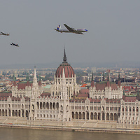 Airplanes fly in front of the Hungarian Parliament during an air show above river Danube crossing central Budapest, Hungary on May 01, 2013. ATTILA VOLGYI