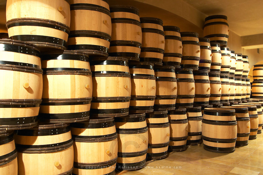 Wooden barrels foraging wine in the cellar of Guigal in Ampuis. The barrels are brand new from the cooperage.  Domaine E Guigal, Ampuis, Cote Rotie, Rhone, France, Europe