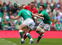 Rugby Union - 2019 pre-Rugby World Cup warm-up (Guinness Summer Series) - Ireland vs. Wales<br /> <br /> Hadleigh Parkes (Wales) attempts to offload under pressure from Jack Conan (Ireland) and Keith Earls (Ireland) at The Aviva Stadium.<br /> <br /> COLORSPORT/KEN SUTTON