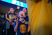 Danny McGee, 7, of San Francisco cheers for the Golden State Warriors during pregame activities against the Cleveland Cavaliers at Oracle Arena in Oakland, Calif., on January 16, 2017. (Stan Olszewski/Special to S.F. Examiner)